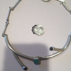 🎉HOST PICK🎉Handmade sterling silver choker 5/23 Thank you cali_girl for the hp on the pop of color party!!!!Handmade in puerto Vallarta sterling silver choker with 3 stones 2 are onyx the middle square stone I am unsure it's opaque teal colored beautiful with a unique clasp!! handmade Jewelry