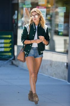 Hailey Baldwin in New York Bomber Jacket & Denim shorts