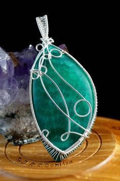 Green Chalcedony pendant wrapped in silver plated copper wire