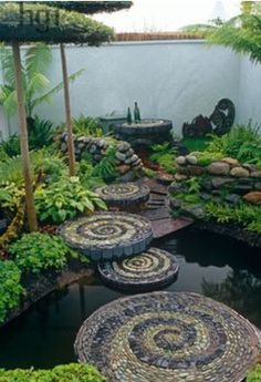 Spirals of pebble. Fun idea for stepping stones