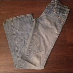 """American Eagle favorite boyfriend jeans 2L AE favorite boyfriend jeans in a light medium wash with some distress.  Size 2 long, inseam is 32.5-33"""" with some wear at the bottom of the jeans.  Extremely soft.  Still have life! American Eagle Outfitters Jeans Boyfriend"""