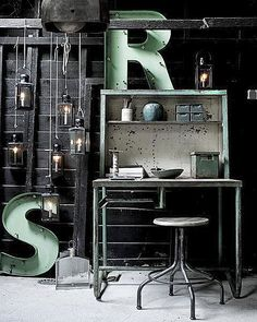 Great industrial working space with lantern lighting and Vintage Marquee Lights, ha my initials! Like the pops of aqua.