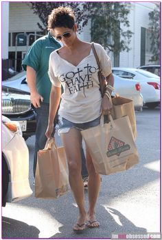 halle berry wears a got to have faith shirt
