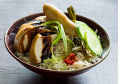 Hainanese Chicken Rice - A much-loved Chinese classic, this Singaporean recipe is an interpretation of chicken rice, using pandan, kecap manis and cucumber to complement the balance of flavours. http://www.sbs.com.au/food/recipes/hainanese-chicken-rice Hainanese Chicken, Chicken Rice, Japchae, Au, Korean, Cucumber, Classic, Chinese, Arroz Con Pollo
