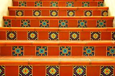 Hand painted Spanish ceramic tiled steps. I absolutely love this look...
