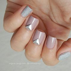 Nude and sliver studded nail art