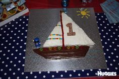 My little man turned one and boats seemed to be his style. So we hand made a cake to suit his first birthday interest. I made a cake from a packet mix as baking is not my strong point. I decorated with Betty's icing mix and placed yummy lollies with a number 1 in style. I placed on a board and decorated with sun and man. So my little sailing boy could float off to bed at last.