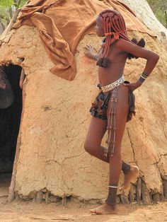 """Himba young girl, Namibia byanilegna (Flickr) (The Himba people are largely subtracted to the western influences and they proudly maintain the customs of the ancestors. They persist to escape from the modern world and from the """"police of the modesty"""", established by the missionaries.)"""