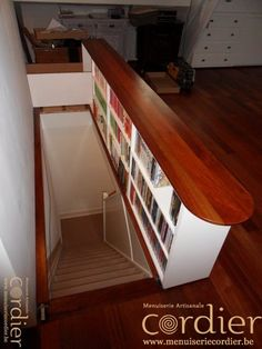 Maybe do this on the opposite Side of the half wall into the kitchen.  It would be a great place for cookbook and small appliance storage.