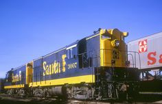 https://flic.kr/p/rfaJLW | AT&SF H16-44 3007 | AT&SF H16-44 3007 at Saint Joseph, Missouri on August 28, 1965, Kodachrome by Chuck Zeiler.  Built by Fairbanks-Morse in June 1951 (c/n 16L508), delivered in the black Zebra Stripe paint scheme, it was retired and traded to EMD during 1968.  The Santa Fe placed two orders for H16-44's, the first order was for ten units (#'s 2800-2809, later 3000-3009) and were what would be considered Phase 1.  The identifying features of the Phase 1 design ...