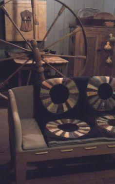 Rope sofa and antique quilt.