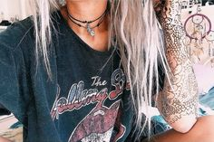 Love both the shirt and the necklaces... and her hair