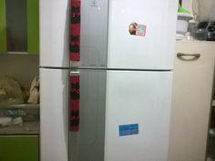 Puxador de geladeira feito com tecido e feltro