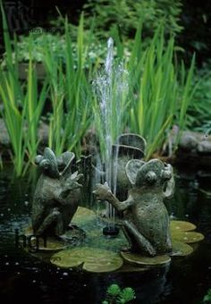 Harpur Garden Images :: mjmc21 Frog fountain in small pond. Design: Jean M Clark Water Water lilies Ornaments Animals Small water features Ponds Fountains Marcus Harpur Please read our licence terms. All digital images must be destroyed unless otherwise agreed in writing. Photograph by: www.harpurgardenlibrary.com Contact: Harpur Garden Library 44 Roxwell Road Chelmsford Essex CM1 2NB, UK