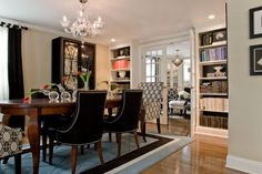 Library Bookcases in the Dining Room. I love that. Also love the chairs. Kristin Drohan Design Portfolio
