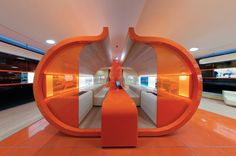 At a bricks and mortar offshoot of an online bank, its pumpkin avatar inspired a customer-service pod's shape and color. ING Direct, Rome. Newtone Architects.