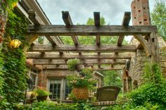 There is no  limit as to how reclaimed beams can be used ... here they created a gorgeous outdoor pergola by Timber and Beam.