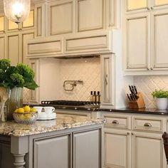 M. E. Beck Design - kitchens - antique, ivory, kitchen cabinets, polished, granite, tops, gray, kitchen island, granite, top, pot filler, arabesque Tile, arabesque tile backsplash, arabesque tile glossy white, arabesque tiles, 2 tone kitchen, 2 tone kitchen design, Mission Stone & Tile Beveled Arabesque Tiles,