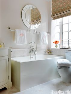 Subtly pink bathroom. Designed by Christina Murphy. housebeautiful.com #marble_tile #pale_pink_accents #master_bath #pink_paint