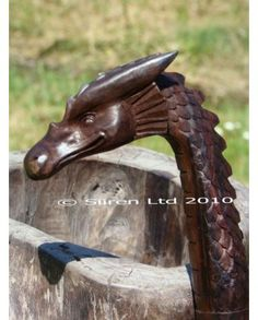 Beautiful fairtrade solid wooden dragon walking stick. WANT SO VERY MUCH.