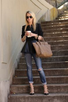 Peplum Black Shirt Paired With Light Skinny Jean. Amazing Black & Gold High Heel Strapy Sandal And An Oversized Satchel