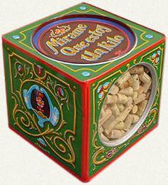 Lata de galletitas  Alfredo Genovese (1996)  Esmalte sintético sobre hojalata.  Medidas: 30 x 30 x 30 cm.