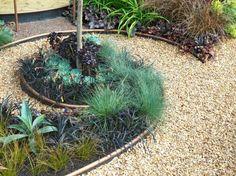 décoration jardin spirale boule pierre metal