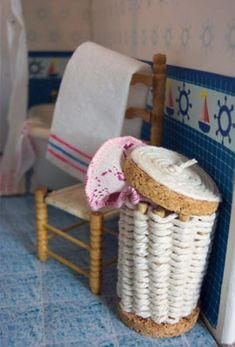 "Laundry hamper made from ""cork rings, toothpicks and string"" 