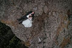 camera toss portrait bride groom laying by cliff wedding Matt Shumate photography bride & groom