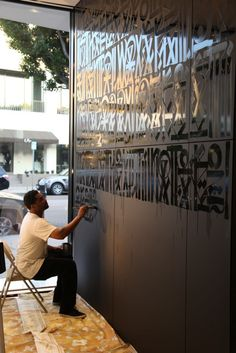 Retna's work. Gloss lettering on matte walls in the same color.