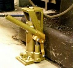 Homemade toe jack constructed from a modified 2-ton bottle jack, a foot, and a steel base.