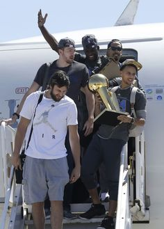 Warriors guard Stephen Curry carries the championship trophy next to Andrew Bogut, David Lee, Draymond Green, and Shaun Livingston in Oakland, Calif., Wednesday, June 17, 2015. <span class=meta>AP Photo/Jeff Chiu</span>