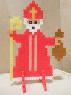 St. Nicholas perler bead project. Find the pattern here! Put those colorful little beads to work in a new way: inspire kids to come up with their own Saint and religious designs!