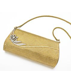 Lady's diamond evening bag, 1960s The clasp with a floral motif set with brilliant- and single-cut diamonds, opening to reveal a mirror, Italian assay marks, accompanied by detachable kings chain strap.