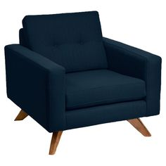 "Midcentury-inspired arm chair with navy linen upholstery and a button-tufted back cushion. Made in the USA. Product: ChairConstruction Material: Wood and linenColor: NavyDimensions: 34"" H x 38"" W x 38"" D"