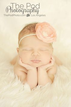 Newborn baby girl holding up her head on white fur fabric to infinity with coral headband www.ThePodPhoto.com