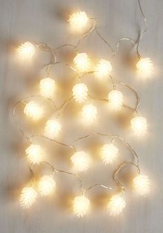 A set of string lights shaped like pinecones.