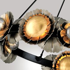 Looking for a totally enchanting chandelier? Look no further than the aptly-named Magic Garden chandelier by Martyn Lawrence Bullard for Corbett Lighting! Mouth-blown smoked glass diffusers radiate from the core of the mixed metal petals. Hand-crafted iron flowers contrast satin black, graphite, and bronze leaf for a wild work of dramatic decorative fantasy.   #chandelierlighting #chandeliermodern #lightingideas #uniquelighting #homelighting