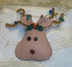 Felt Hand Stitched Reindeer Ornament by piecebypieceva on Etsy, $5.00