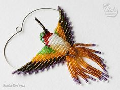 Beaded Bird Ornament, Bird Suncatcher, Window Decor, Bird Necklace, Hummingbird Figurine, Bird Lover Gift, Rufous Hummingbird (S) / BB#124 > Approximate dimensions: W 3 1/4 inch (8.5 cm) H 3 inch (7.5 cm) / 3 3/4 inch (10 cm) with hanging wire D 2 inch (5 cm) === 4 finish options === > 1. Suncatcher / Window Decor / Mirror Decor With this option, this beautiful beaded bird comes with a small suction hook and may be used as...