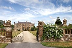 Main Entrance & drive of Brympton House in Somerset, England. The first part of the house was started in the 13th century by the D'Evercy family Operated as a Wedding Venue it also hosts events such as literary festivals.