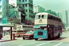 Shaukeiwan Road towards the East in early 1980s  This picture shows all our favourite old HK transportation: China Motor Bus (one old, one newer), taxi (the meters were not electronic!) and red minibus.   http://www.facebook.com/W.Foundation