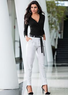 Black Surplice top with faux leather belted pant from VENUS. Top sizes XS-XL and bottom sizes 2-14!