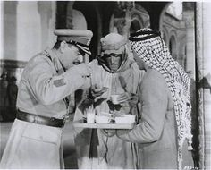 Peter O'Toole and Jack Hawkins taking tea on the set of 'Lawrence of Arabia' in The British epic film based on the life of T. Lawrence and directed by David Lean. Peter O'toole, David Lean, Epic Film, Lawrence Of Arabia, Film Base, Fun Cup, Movies And Tv Shows, Cinema, Around The Worlds