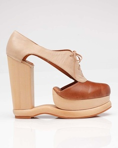 Cut out platform heels from Jeffrey Campbell. Features two-toned oxford inspired styling with side cut out detail and front lacing. Polished wood platform and heel. Funky Shoes, Crazy Shoes, Me Too Shoes, Weird Shoes, Dream Shoes, Jeffrey Campbell, Moda China, Oxford Wedges, Oxford Shoes