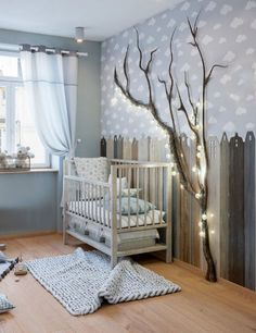 Light blue and white cloud themed baby nursery room wall décor ideas for a baby boy's room