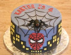 This is a Spiderman cake that I designed for a special 4 year old boy.  Buttercram frosting with a fondant spider, batman face and skyline.