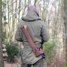 The Woodlore Folding Buck Saw, pictured with its carry case and the Ray Mears Wilderness Axe (not included) (Click for full size)