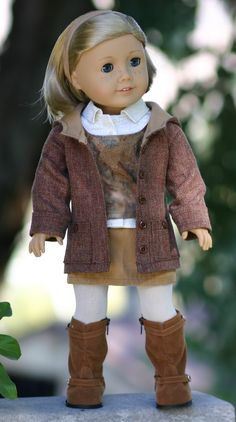 """Christmas for Haley,"" by Christine Smith of Doll Closet Heirlooms.  Christine used a modified Liberty Jane pattern to create the jacket.  (The rest of the outfit is made with original designs.)"