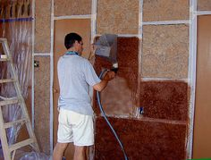 """Here's an inexpensive alternative to the usual way wall partitions are built. Instead of framing up, then insulating with fiberglass and covering with sheetrock, the wall cavities are filled with a mixture of straw and clay (known as """"cob""""). The wall is formed up in sections."""
